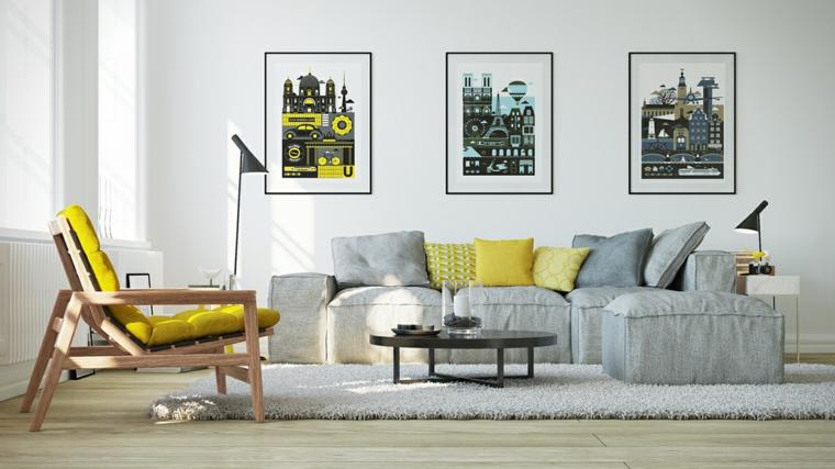 soggiorno con divano grigio decrazione cuscini in giallo parete con quadri