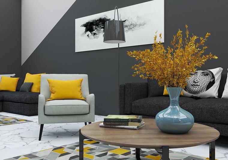soggiorno con pareti di colore grigio tavolino con vaso cuscini in giallo che significato colore pantone