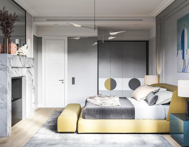 zona notte con camino letto di colore giallo pareti dipinte di grigio colori pantone