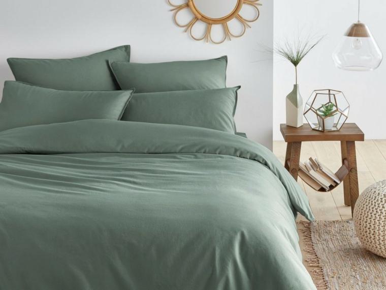 arredare con il verde biancheria da letto colore salvia parete bianca con decorazione