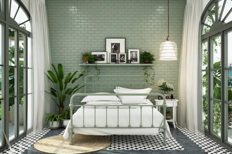 camera da letto con finestre parete verde effetto piastrelle decorazione con piante da appartamento