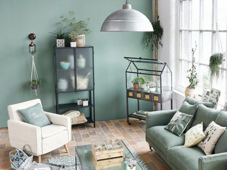 colore verde vintage parete dipinta di salvia soggiorno con divano e poltrona in tessuto