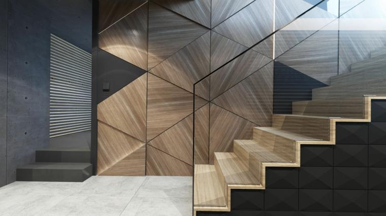 corridoio con scale interne rivestimento parete con pannelli in legno figure geometriche