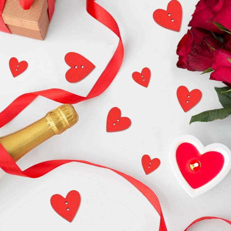 cosa posso regalare al mio ragazzo per stupirlo bottiglia di champagne e cuori
