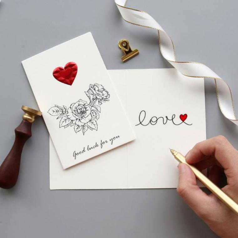 cosa regalare a san valentino cartolina fatta a mano con disegno cuore e scritta love