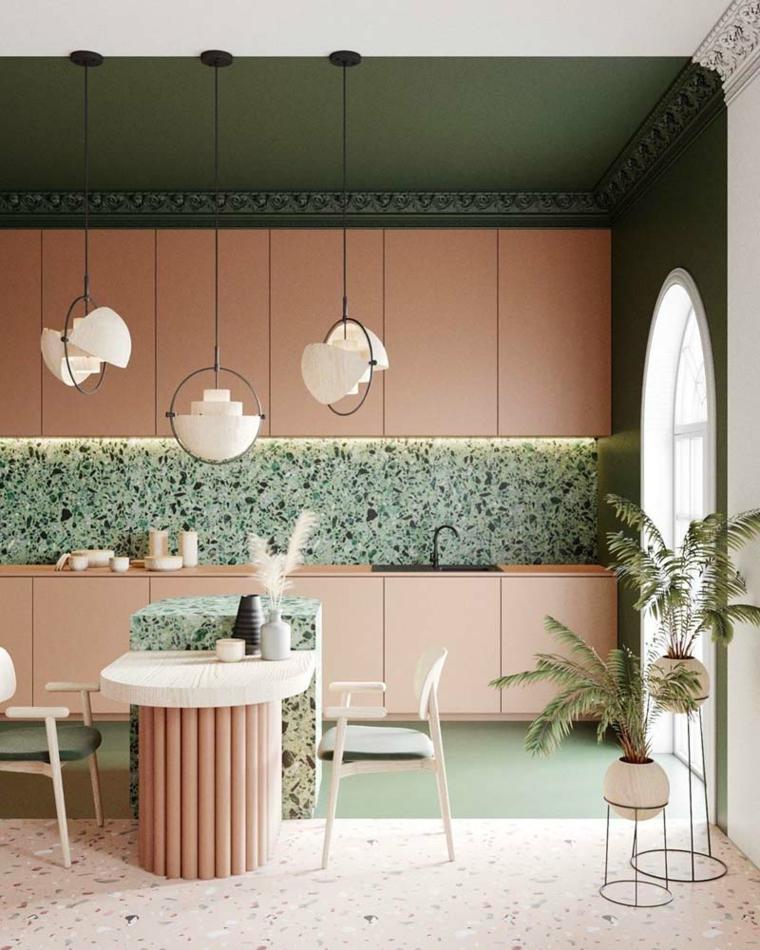 parete verde salvia cucina mobili ante legno colore rosso isola centrale con tavolo da pranzo