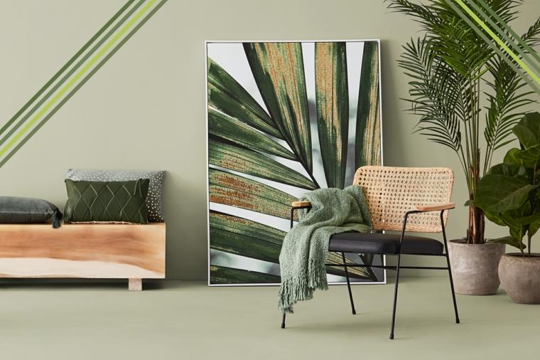 salotto decorato con piante da appartamento tonalità di verde per pareti