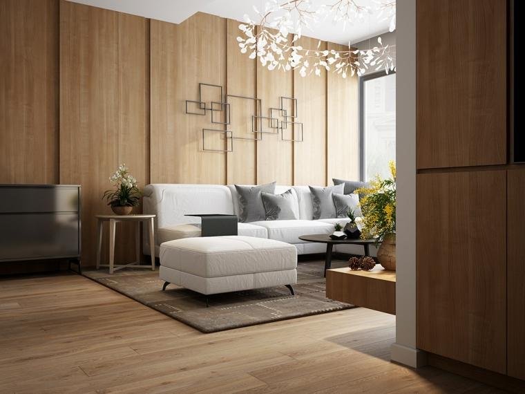 soggiorno con divano bianco parete rivestita con pannello in legno boiserie