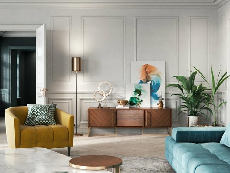 soggiorno con divano blu parete di colore bianco con boiserie effetto legno