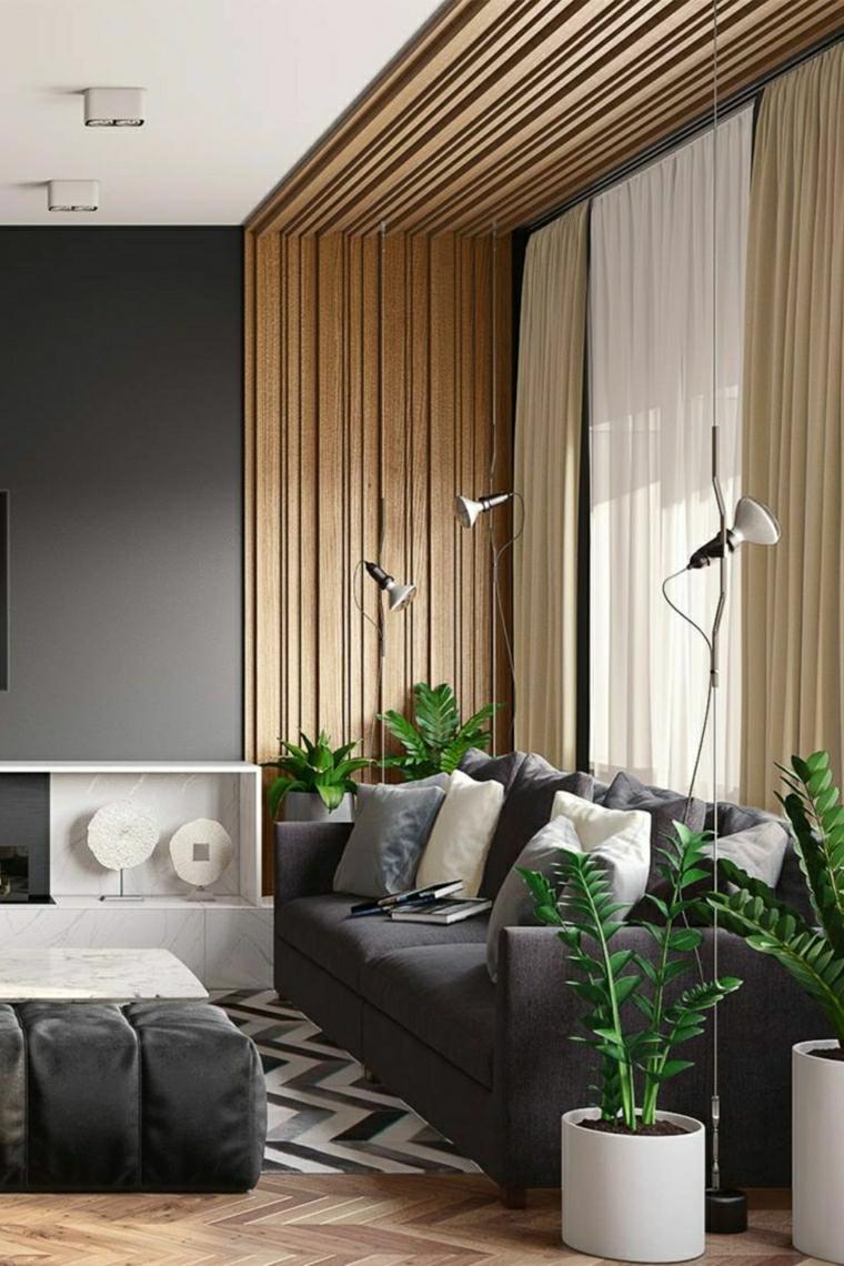 soggiorno con parete e soffitto in lastre di legno divano grigio tre posti
