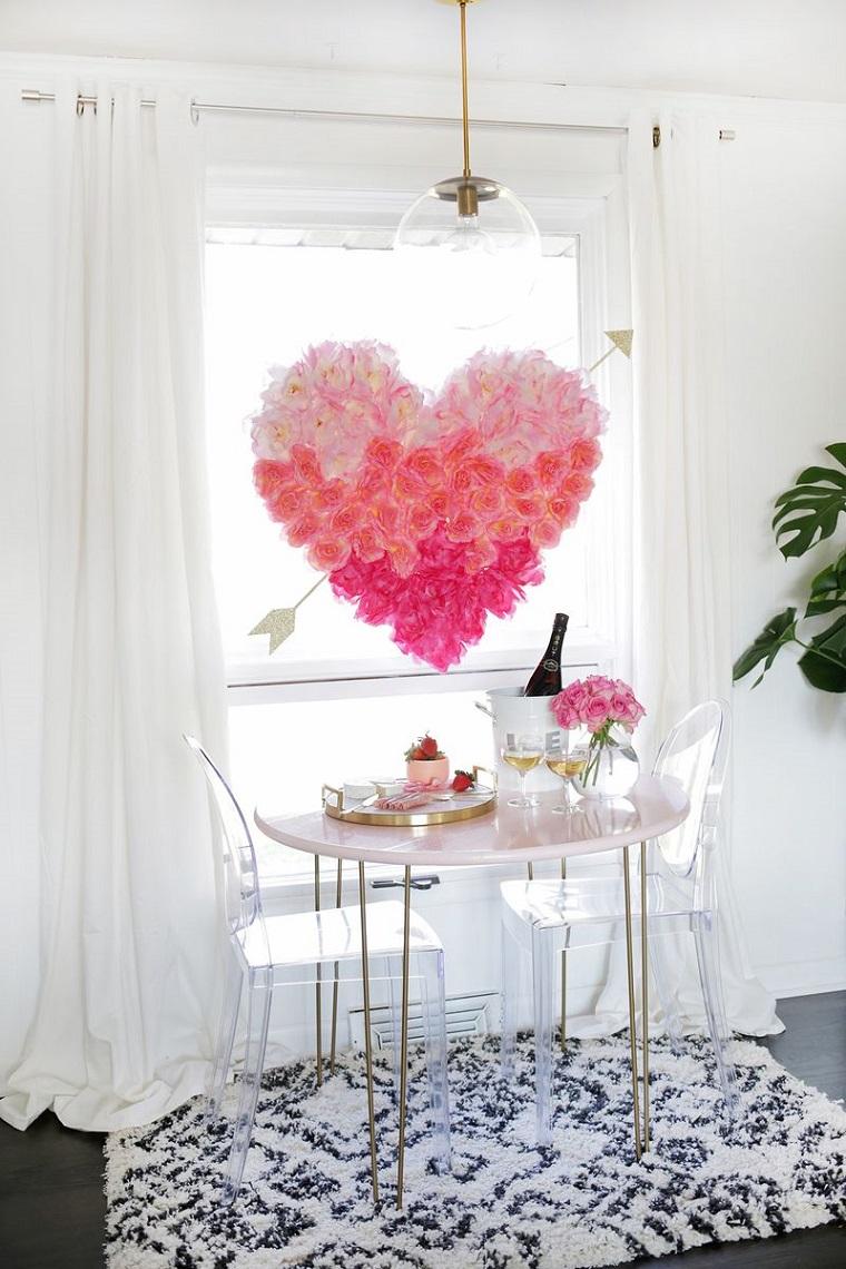 sorprese per lui fai da te preparazione cena romantica decorazione con grande cuore di carta