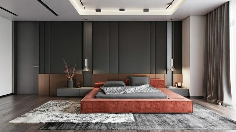 zona notte con pareti bicolore letto di colore arancione pavimento in legno con tappeto