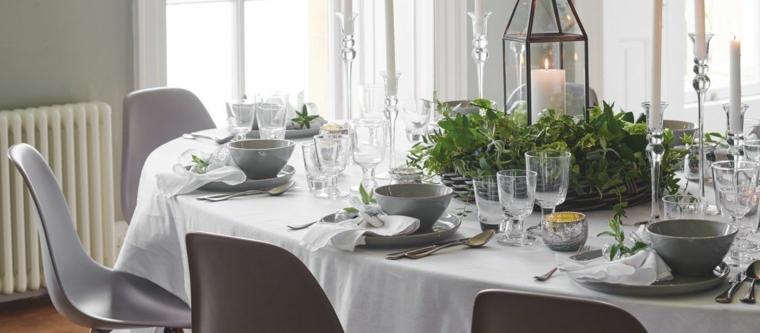 apparecchiare la tavola decorazione con centrotavola rametti verdi e candele