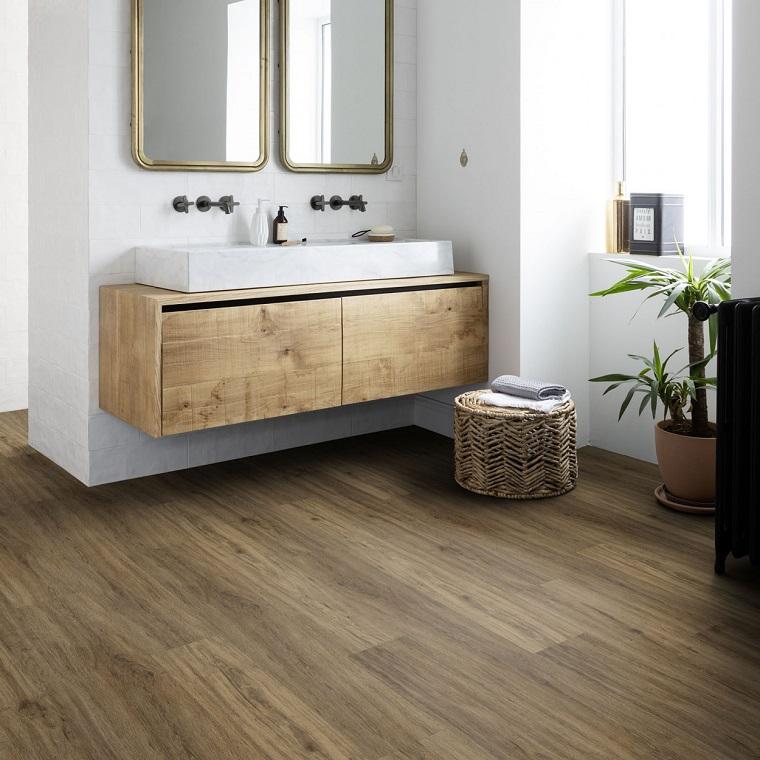 arredamento bagno con mobile sospeso pavimento in pvc di colore marrone