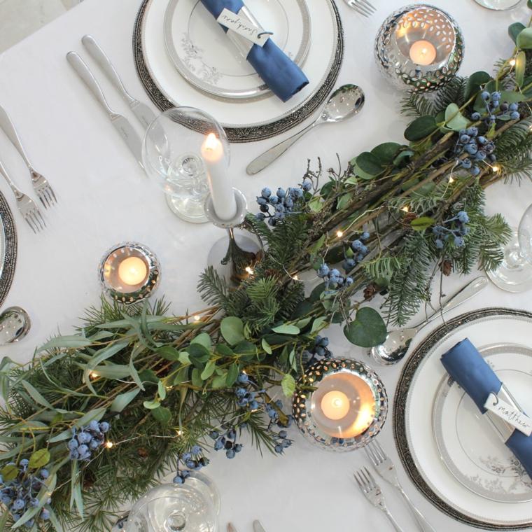 centrotavola con rami e fiorellini tovagliolo abbinato decorazione tavola con candele