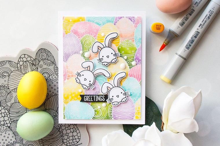 biglietti pasquali fai da te cartolina con conigli tridimensionali disegno con pennarelli