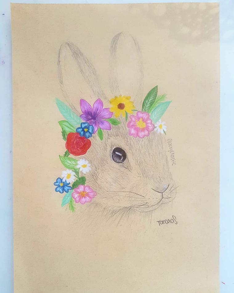 coniglietto pasquale disegno schizzo di coniglio con corona di fiori
