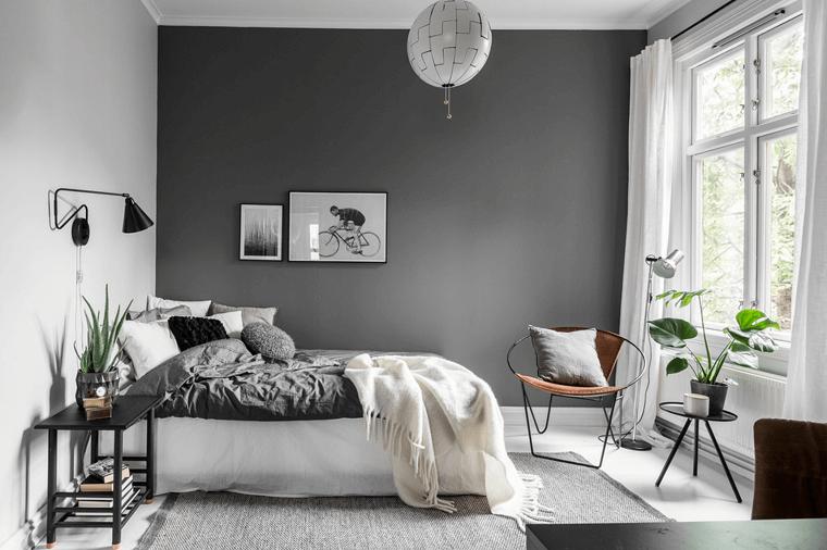 decorazione interno con piante verdi pareti bicolore camera da letto grigio e bianco