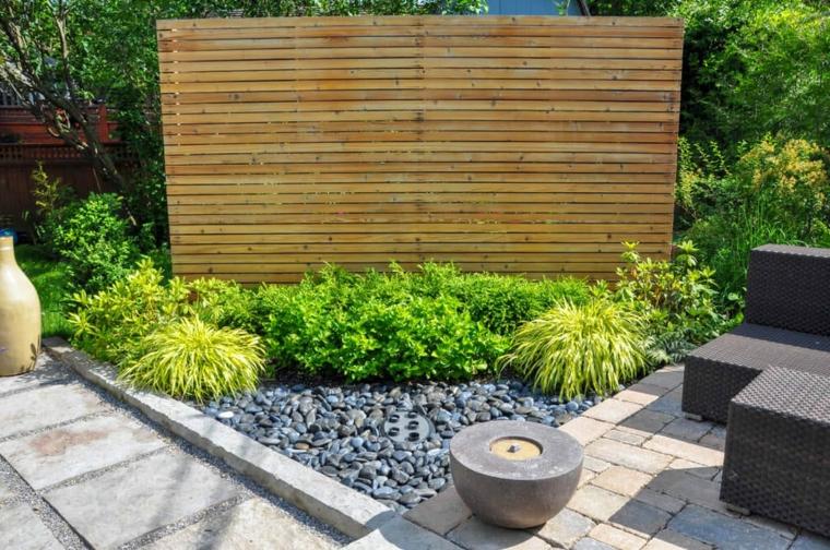 giardini moderni con sassi vegetazione con piante foglia verde