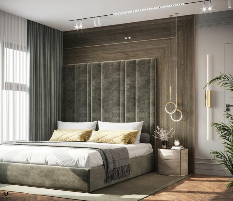 illuminazione con faretti e lampade sospese pittura bianca pareti camera da letto boiserie in legno moderna