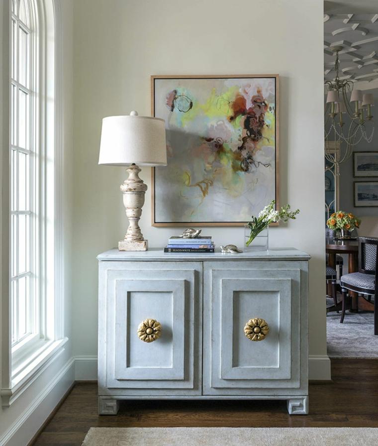 soggiorno con mobili di legno verde tiffany origine decorazione parete con quadro