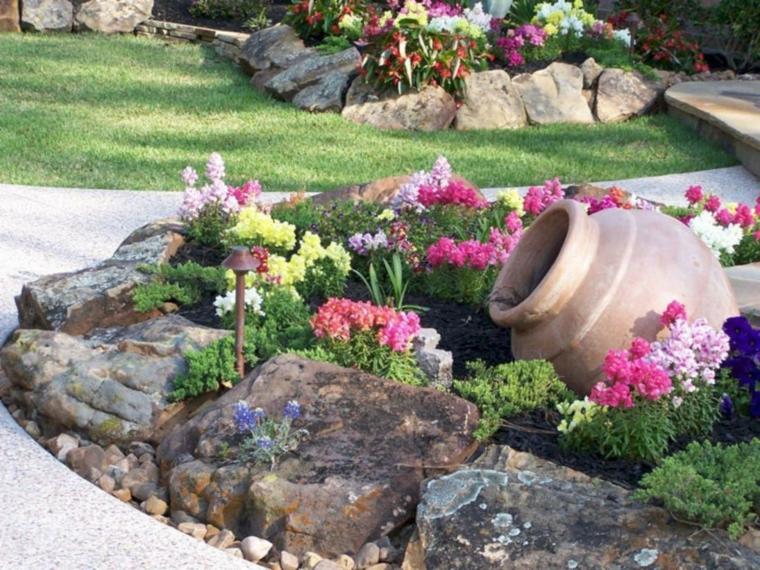 come costruire una aiuola decorazione giardino con sassi e anfore