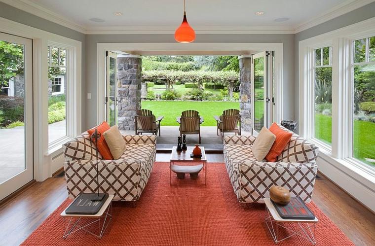 copertura giardino d inverno arredamento con divani in tessuto e tavolino