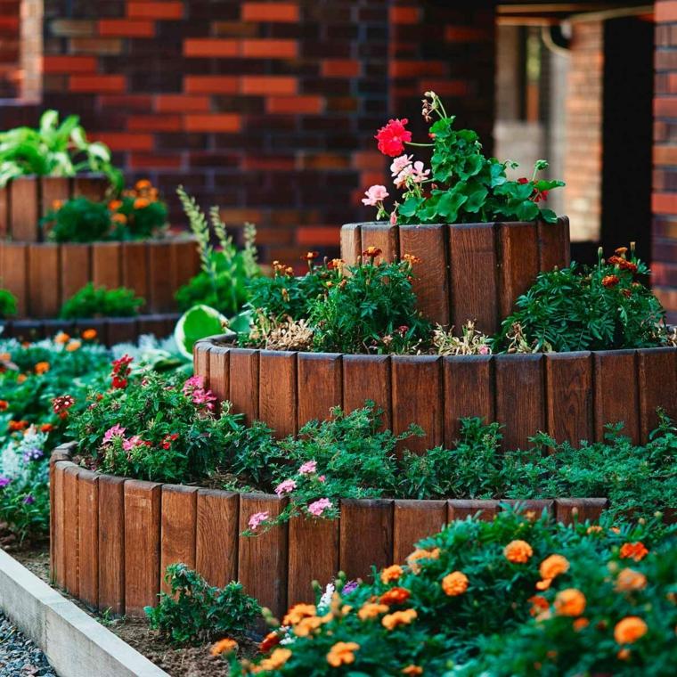 cordoli per aiuole fai da te giardino con piante dalla foglia colorata