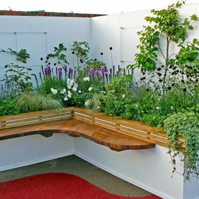 giardino con panchina angolare bordure per aiuole dai fiori colorati