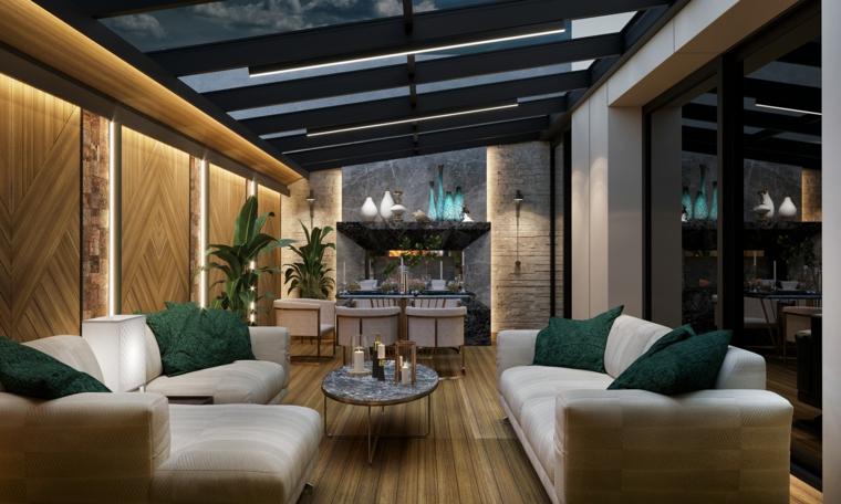 giardino d inverno moderno arredamento con due divani soffitto con vetrate