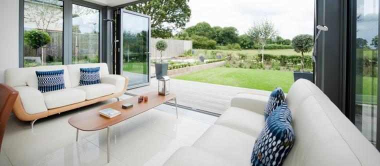 giardino d inverno moderno arredamento con due divani sunroom con porte scorrevoli di vetro