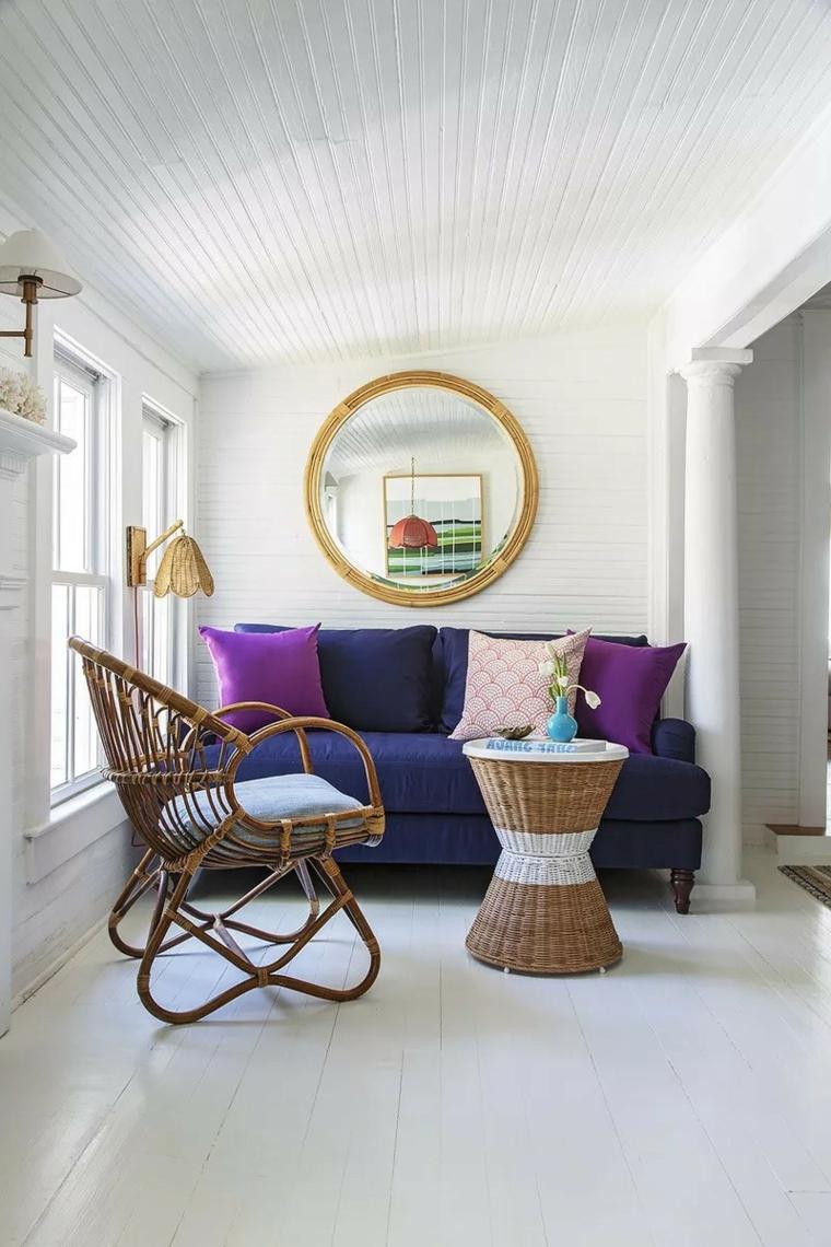 giardino d'inverno arredamento divano in tessuto con cuscini sedia e tavaolino in rattan