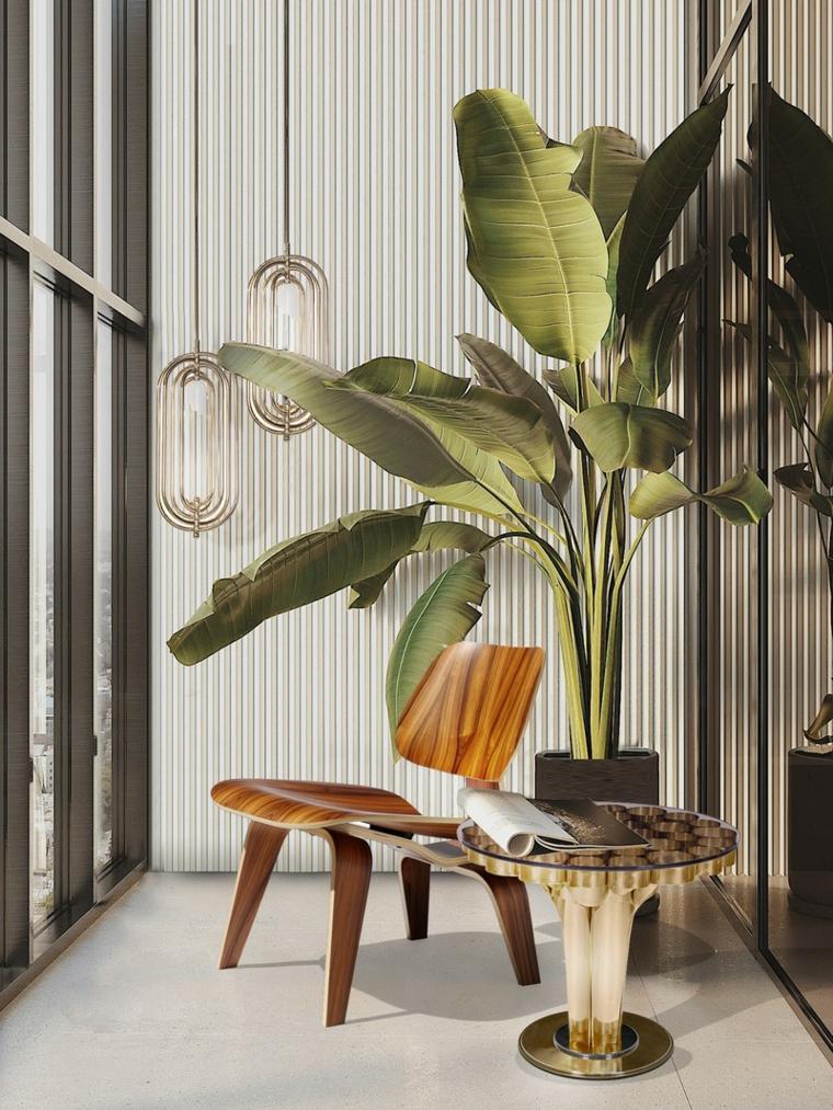 pianta grande dalla foglia verde arredamento con sedia e tavolino basso in legno