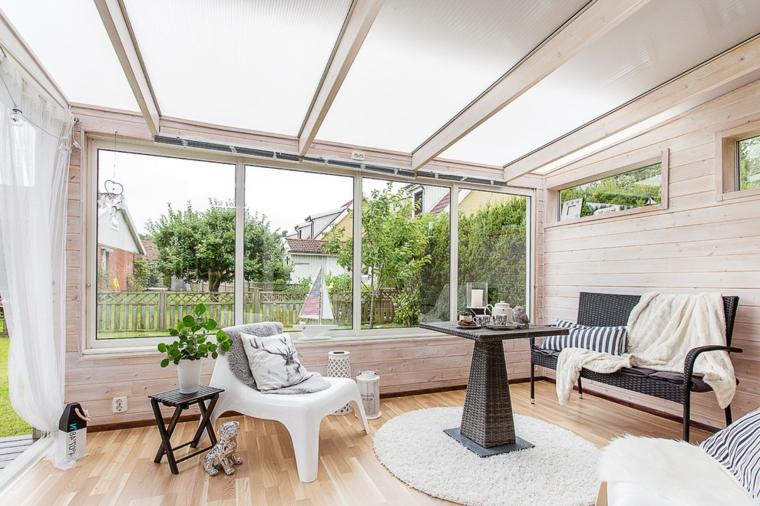 sunroom con tetto vetrato giardino inverno abitabili arredamento con tavolo da pranzo e panchina