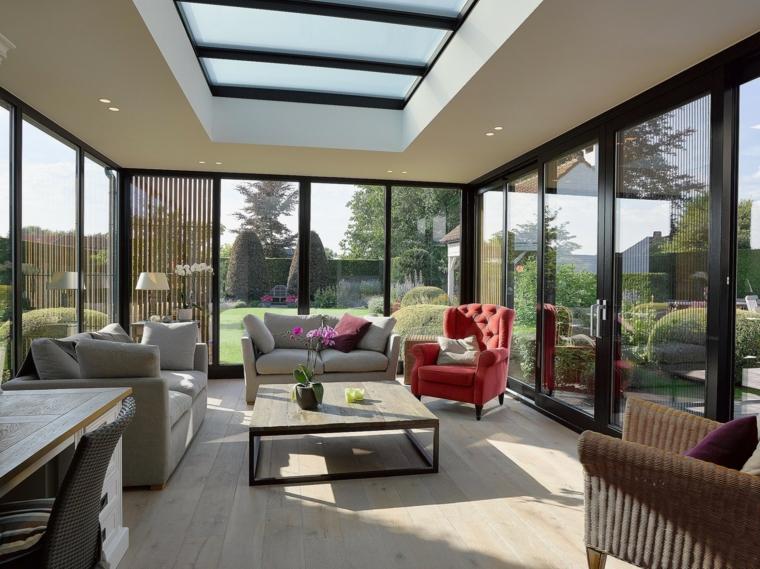veranda coperta con vetrate arredo con set di mobili da soggiorno