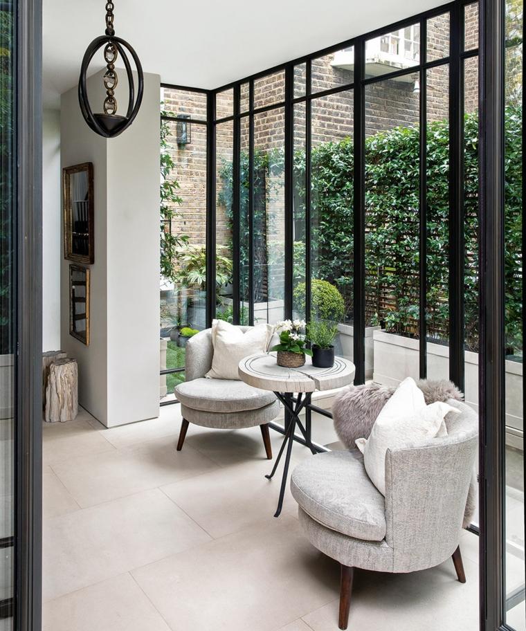 veranda esterna con porte di vetro arredamento con set di mobili da caffè