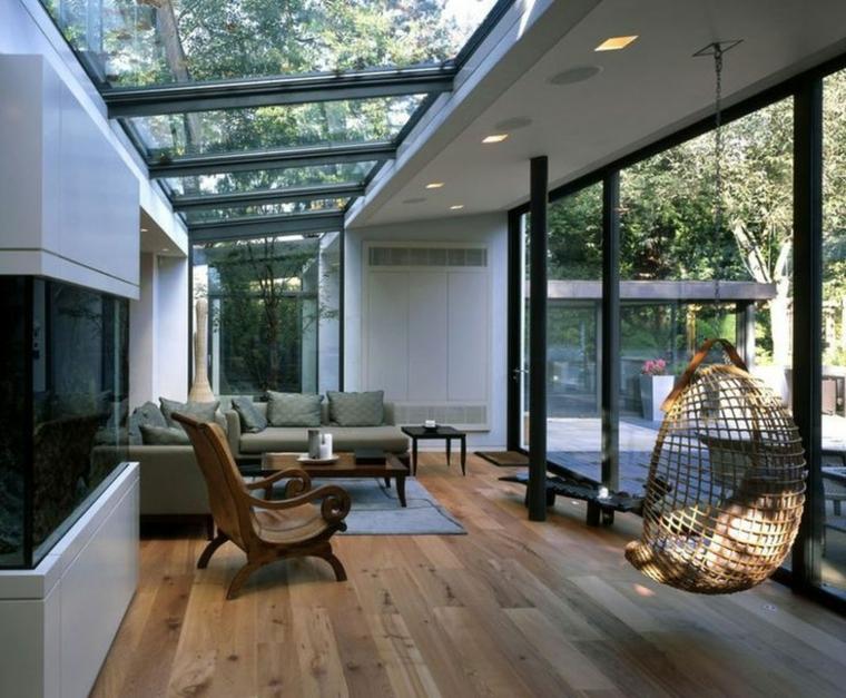 veranda giardino d inverno arredo con divano angolare in tessuto decorazione con camino a legna