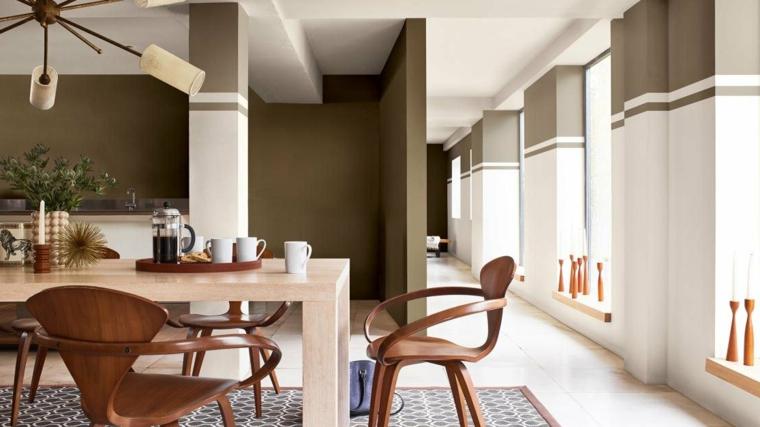 sala da pranzo con pareti dipinte di colore verde oliva tavolo da pranzo in legno