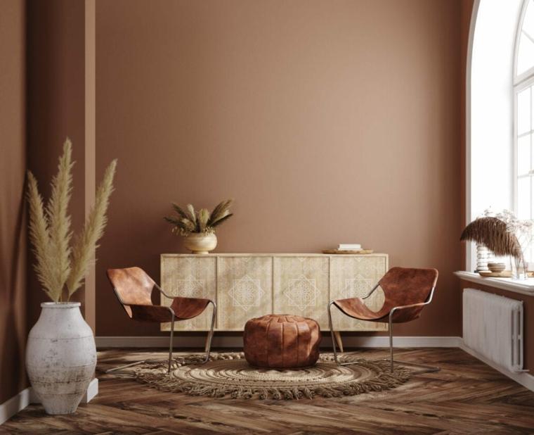 salotto con mura tinteggiate di colore marrone terra arredo con mobile in legno