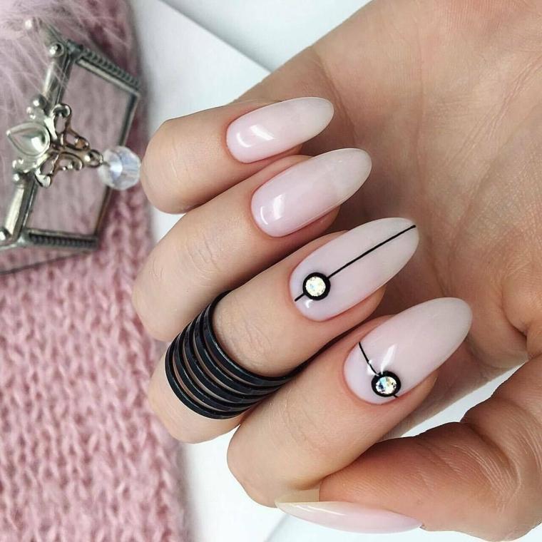 stiletto rosa pallido con disegni geometrici decorazione unghie con brillantini