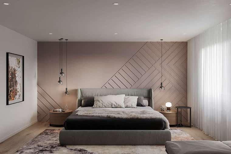 camera da letto con pareti dipinte di color terra comodini con lampade a sospensione