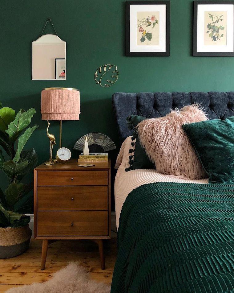 pareti dipinte di verde salvia camera da letto con mobili in legno